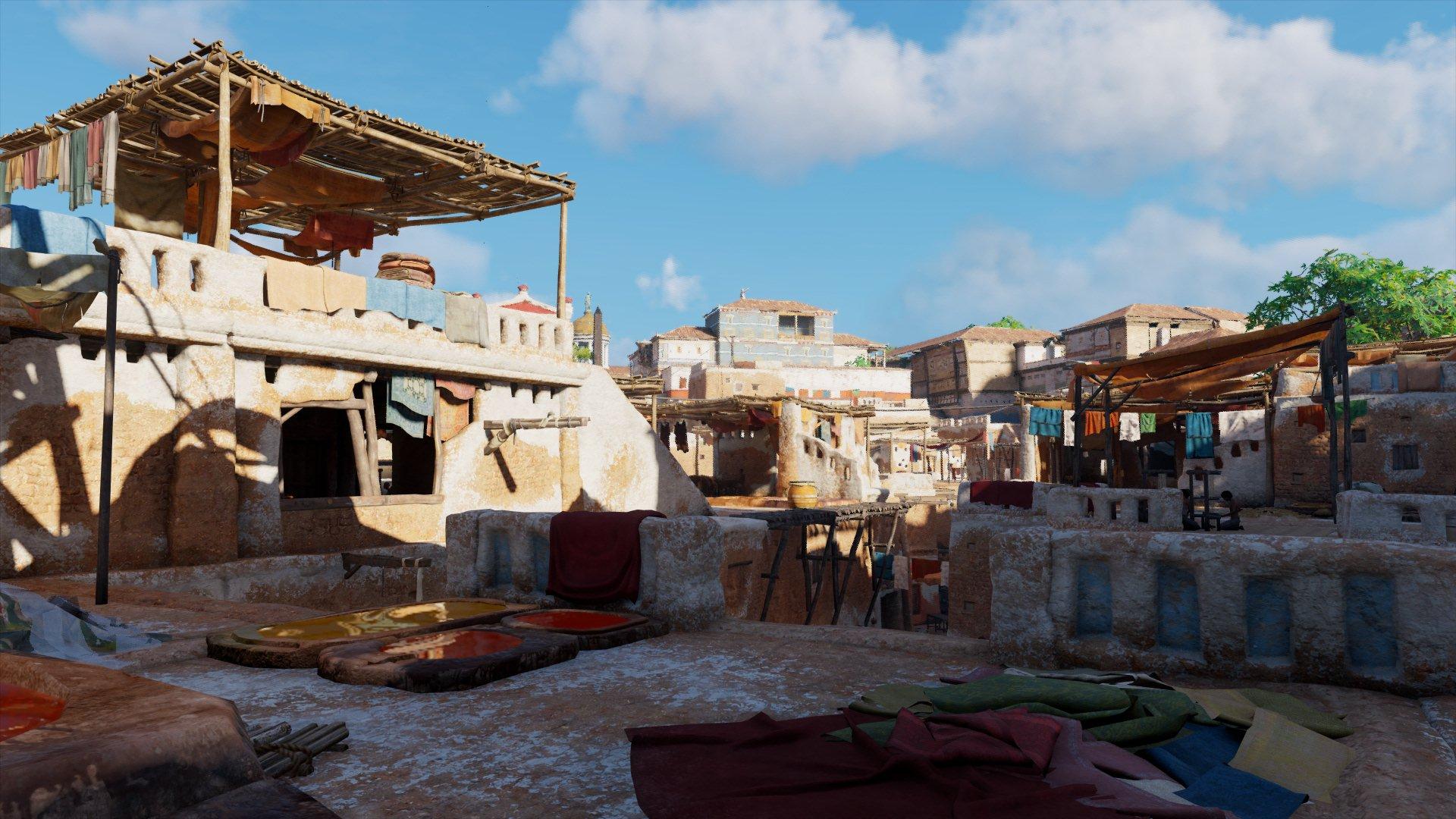 Ob dreckige Wäsche, spielende Kinder oder eine Färberei auf dem Dach: Oft sind die alltäglichen Szenen in Alexandria die, die am meisten faszinieren (Quelle: Assassin Creed: Origins, Ubisoft)